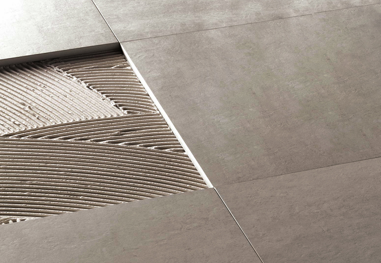 Adesivo per piastrelle adekoll as100 extra flex grigio a - Piastrelle garage prezzi ...